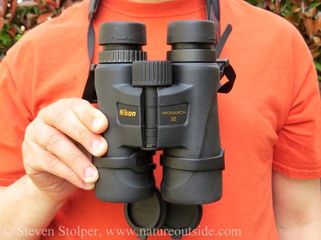Person wearing Monarch 5 8x42 binoculars