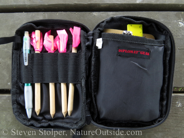 BDU pocket organizer filled with animal tracking tools