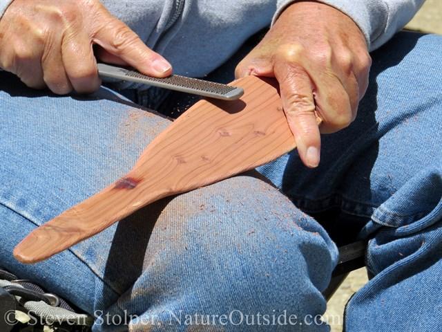 filing edge of cedar ceremonial canoe paddle