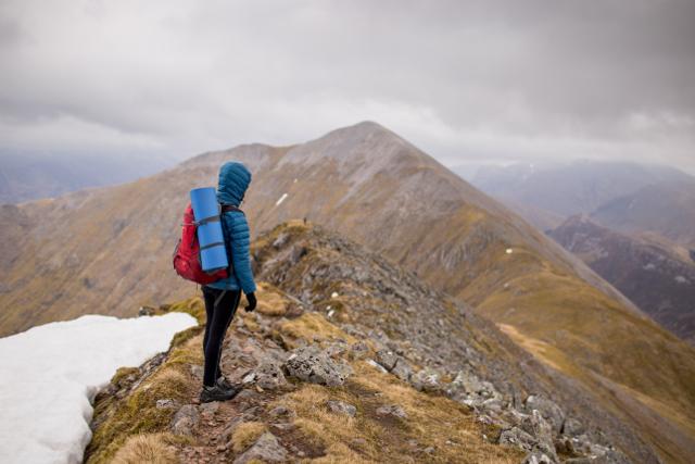 woman hiker on mountain ridge